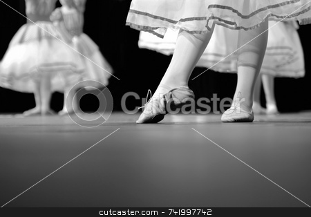 Dance Recital in black and white stock photo, Dancers on stage during a recital. Originally shot in Black and White. Noise reduction was applied on the floor and the dancers in the background but not the foreground dancer. by Mitch Aunger