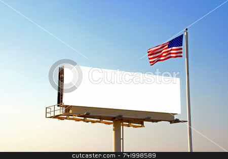 Billboard and American Flag stock photo, A roadside billboard with an American Flag next to it. The sun was behind the billboard and to the left by Mitch Aunger