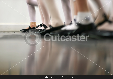 Tap Dance Class in Motion stock photo, Young dancers are learning - this group is vigorously tapping with tap shoes. Lots of motion by Mitch Aunger