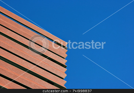 Blue Sky and Red Brick Building on the diagonal stock photo, On a bright blue fall day, we find a newly constructed brick building with some interesting diagonal lines and plenty of copyspace. by Mitch Aunger