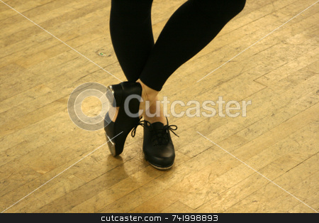 Tap Dance Shoes stock photo, Tap Dancer poses with taps exposed. by Mitch Aunger