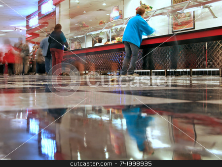 A blurry cafeteria line stock photo, An all you can eat pizza/cafeteria joint - the shot is from the checkered floor looking across at the food line and with a time exposure, some of the customer movement is blurred by Mitch Aunger