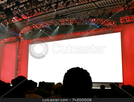 Blank stage background for a message stock photo, The stage at a keynote presentation for a large conference... the screen has been blanked out for you to fill in your own message. by Mitch Aunger