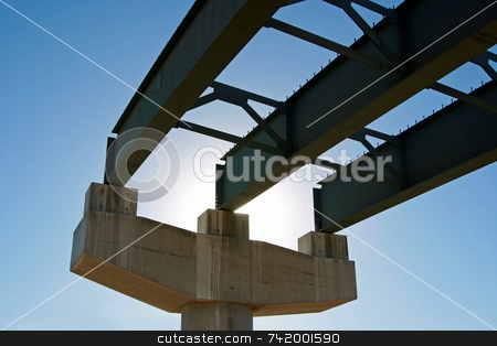 New Highway Construction Pillar and Incomplete Roadbed stock photo, New highway bridge being built - viewed from underneath and looking toward the sun. This portion of the bridge is incomplete and there's no road decking. by Mitch Aunger