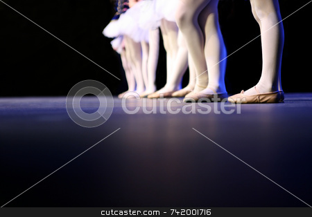 Recital dancers standing in a line stock photo, Dancers on stage during a recital. Noise reduction was applied on the floor and the dancers in the background but not the foreground dancers. by Mitch Aunger
