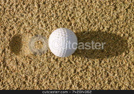 Golf ball in the sand with a pitch mark stock photo, Golf ball in the sand with a pitch mark by Stephen Rees