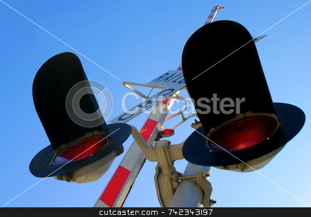 Rail Cro stock photo, Railroad Crossing signal from below with sky in the background by Henrik Lehnerer