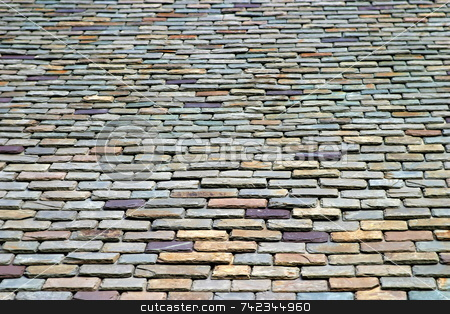 Roof Tiles stock photo, Colorful stone roof tiles from below by Henrik Lehnerer