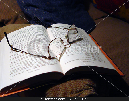Open book stock photo, Open book with glasses on pages by Jack Schiffer