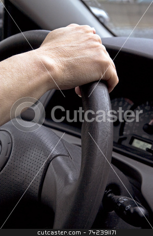 Driving stock photo, Holding steering wheel by Jack Schiffer