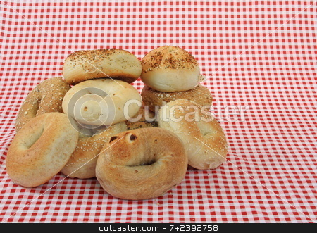 Bagels stock photo, Stack of Bagels on red and white table cloth by Jack Schiffer