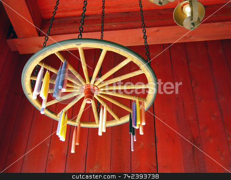 Candles Drying  stock photo, Candle hung to dry on wagon wheel by Jack Schiffer