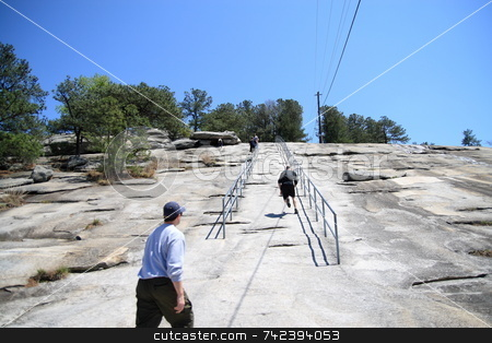 Stone mountain Top stock photo, Walking a steep section of stone mountain by Jack Schiffer
