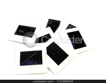 Slides stock photo, Assortment of slides on white background by Jack Schiffer