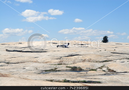 In Shape stock photo, Man excercising on top of Stone mountain Georgia by Jack Schiffer