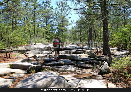 Mountain Hiker stock photo, Hicker with backpack hiking stone mountain Stone Mountain is claimed by some to be the largest exposed granite 'stone' in the world by Jack Schiffer