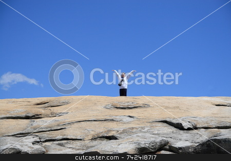 Queen Of The Rock stock photo, Women waving on a high ledge of Stone Mountain by Jack Schiffer