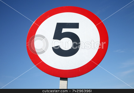 A round 5 miles per hour sign and a blue sky. stock photo, A round 5 miles per hour sign and a blue sky. by Stephen Rees