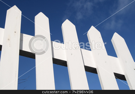 White picket fence and a blue sky. stock photo, White picket fence and a blue sky. by Stephen Rees