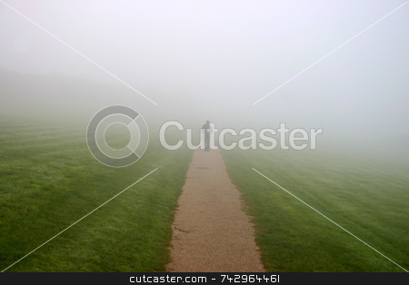 A man walking in to the mist stock photo, A man walking in to the mist by Stephen Rees