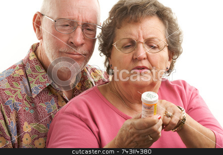 Senior Couple with Perscription Bottle stock photo, Senior Couple reads a perscription bottle. by Andy Dean