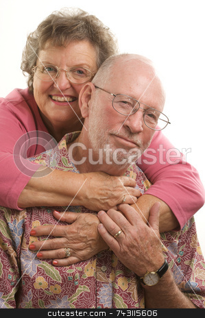 Happy Senior Couple stock photo, Affectionate, Happy Senior Couple poses for portrait. by Andy Dean