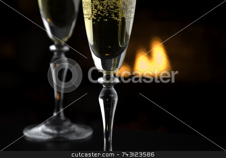 Fireside Champagne 1 stock photo, Shallow focus view of 2 glasses of champagne by the fire. Suitable for queit getaways, Valentines Day, Christmas holidays and others. by Vince Clements
