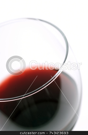 Macro of red Wine stock photo, Macro of a glass of wine with shallow focus on the glass lip by Vince Clements