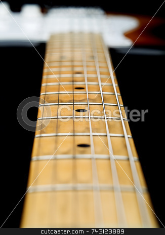 Close up of electric guitar neck stock photo, A closeup of a well worn 20 year old  electric guitar neck looking from the headstock to the 5th fret by Vince Clements