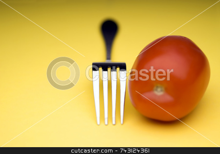 Fork and tomato  stock photo, Snappy image of a fork and a tomato on a bright yellow background by Vince Clements