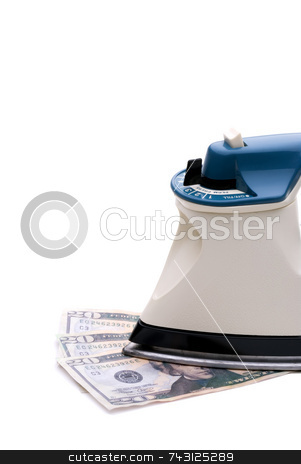 Ironing out the economy stock photo, Iron on money to indicate ironing out the economy or money laundering by Vince Clements