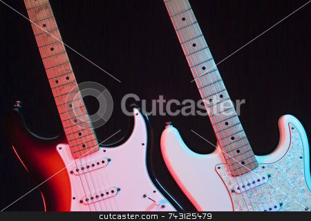Two electric guitars on the stage stock photo, Two electric guitars on the stage under the stage lights ready to be played by a guitar hero by Vince Clements