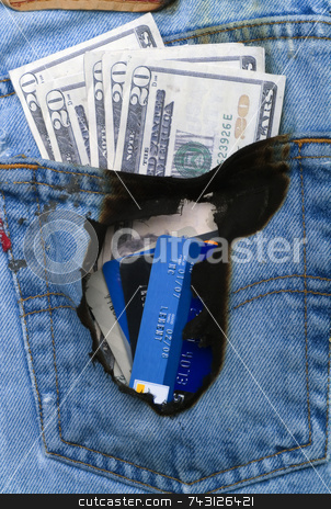 Burning a hole in my pocket 3 stock photo, Concept image of money burnt a hole in a jeans pocket by Vince Clements