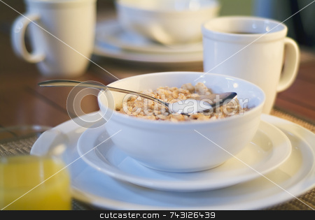 Breakfast cereal in the morning sun stock photo, Cereal and coffee for breakfast basking in the early morning warm sunlight by Vince Clements