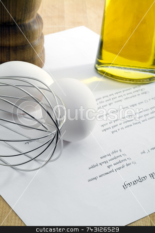 Preparing Ingredients stock photo, A whisk, eggs, olive oil and pepper being gathered to prepare the recipe sitting on a wooden cutting board. by Vince Clements