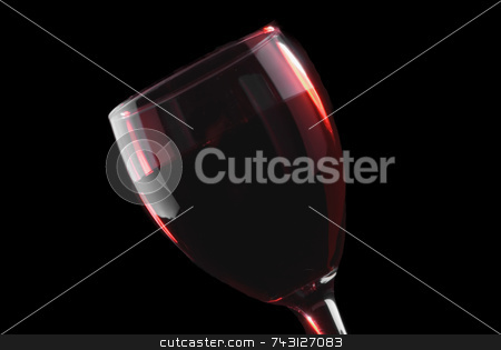Low key red wine glass stock photo, Low key red wine glass on a black background by Vince Clements