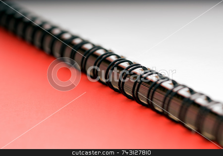 Macro of a ring bound document - on red stock photo, Macro of a white spiral ring bound document - on a red background by Vince Clements