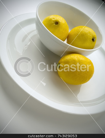 Lemons in a bowl stock photo, Tilted view of lemons in a bowl by Vince Clements