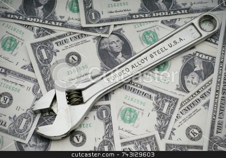 Fixing the American Economy stock photo, Concept of fixing the US economy with a wrench on US currency by Vince Clements