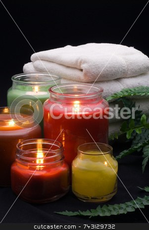 Spa Setting stock photo, A tranquil spa setting with towels and candles by Vince Clements