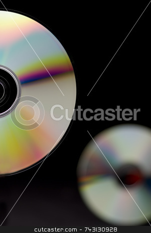 Closeup of CDs stock photo, A closeup of CDs. by Vince Clements