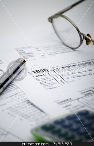 US 1040 Tax form stock photo, Shallow focus view of a US 1040 tax form with calculator and glasses by Vince Clements
