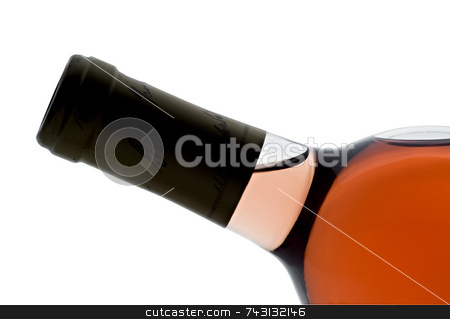 Single bottle of backlit blush wine tilted stock photo, Single titled bottle of backlit blush wine isolated on white by Vince Clements