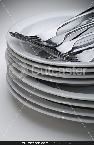 Silverware on stack of plates stock photo, Silverware on stack of plates by Vince Clements