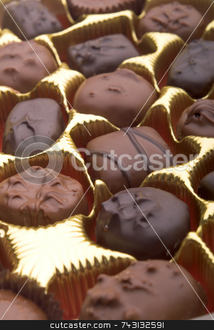 Closeup of chocolates in a box stock photo, A closeup of some chocolates in a box of chocolates. Suitable for Valentines Day topics, birthday topics, anniversary topics by Vince Clements