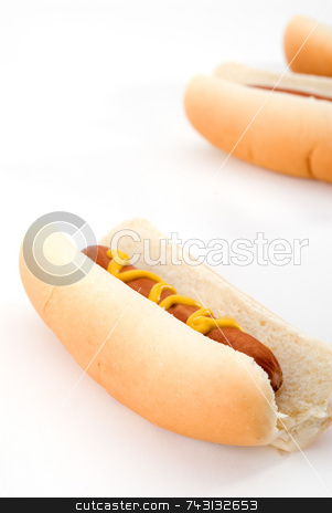 Hot dogs stock photo, Closeup of hotdogs with mustard by Vince Clements