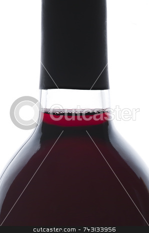 Single bottle of backlit red wine stock photo, Single bottle of backlit red wine isolated on white. A few bubbles for interest by Vince Clements