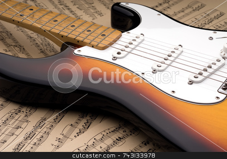 Electric guitar and sheet music stock photo, Electric guitar with a worn maple neck laying on sheet music printed on parchment paper by Vince Clements