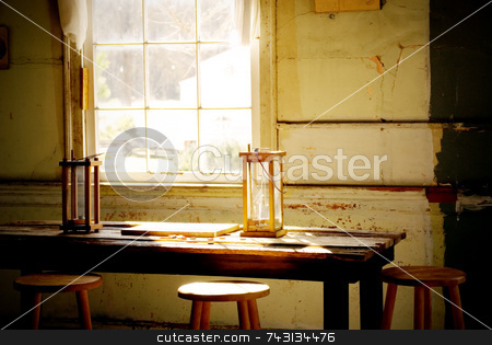 Old candle reading lamps by window stock photo, Two old candle reading lamps by a window by Vince Clements