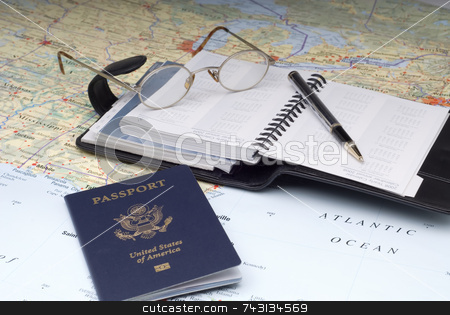 Travel Plans 2 stock photo, A US Passport and a day planner on a map.Possibly planning a cruise vacation by Vince Clements